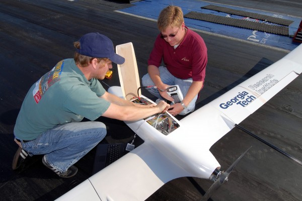 Thomas Bradley and Reid Thomas go through the procedure of starting up the Georgia Tech fuel cell aircraft during a test flight at the Atlanta Dragway.