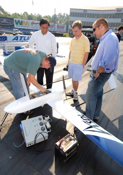 The Georgia Tech team removes the hydrogen tank from the fuel cell aircraft to refill it for flight. Shown are Thomas Bradley, David Parekh, Parker Parrish and Adam Broughton.