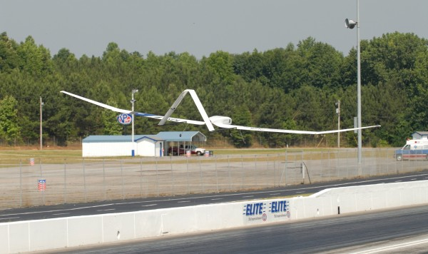 Georgia Tech's fuel cell aicraft flies above the track at Atlanta Dragway. The unmanned vehicle flew for up to a minute at a time during the test flights.