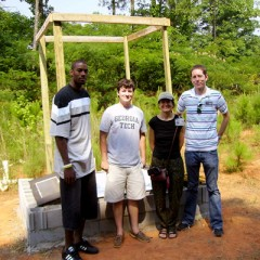 Georgia Tech students Calvin Johnson (left) and Brad Davis with Dr. Christine Moe and Robert Dreibelbis of Emory University.