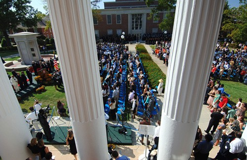 Members of the University of Mississippi family and guests gather on the lawn between the Lyceum and the John D. Williams Library to dedicate the university's civil rights monument, which honors James Meredith and others who pioneered civil rights in the South and across the nation.  As seen in this view from the third floor, between the Lyceum columns, looking toward the John D. Williams Library, the monument occupies a prominent place between the university's landmark administration building and its center of knowledge.