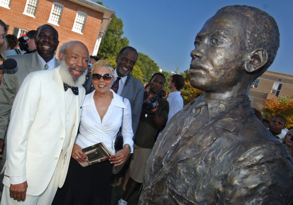 James Meredith (in bow tie) and his wife (right) see his likeness in the form of a bronze statue for the first time Oct. 1 at the dedication of the civil rights monument at the University of Mississippi. The monument honors Meredith and others who pioneered civil rights in the South and across the nation. Located between the John D. Williams Library and the Lyceum, the monument occupies a prominent place between the university's landmark administration building and its center of knowledge.