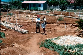 Co-authors Kathleen Deagan and Jose M. Cruxent standing by the foundations of La Isabela's royal storehouse, where metallurgical activities took place.