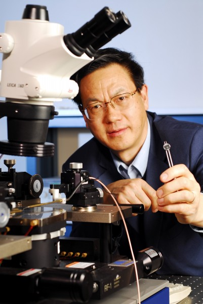 Zhong Lin Wang, Regents Professor in the School of Materials Science and Engineering at Georgia Tech, holds a prototype DC nanogenerator fabricated using an array of zinc oxide nanowires.