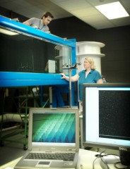 Dr. Amy Lang works with a graduate student in UA's water tunnel lab researching skin friction over solid surfaces.