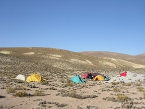 The team's campsite near Salar de Surire. The site can only be reached by 4-wheel drive truck. Team members sleep in tents and cook over a gas stove.