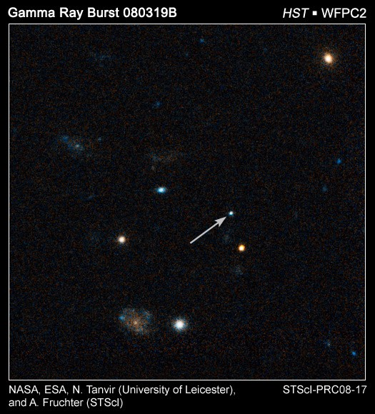 Peering across 7.5 billion light-years and halfway back to the Big Bang, NASA's Hubble Space Telescope has photographed the fading optical counterpart of a powerful gamma ray burst that holds the record for being the intrinsically brightest naked-eye object ever seen from Earth. For nearly a minute on March 19, this single