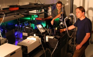 "University of Utah physicists John Lupton and Christoph Boehme use green and blue laser beams to ""excite"" a small piece of an organic or ""plastic"" polymer..."