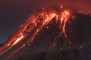 Lava pours out of Montserrat during an eruption. A University of Arkansas researcher and his colleagues have used observations to create a new model that...