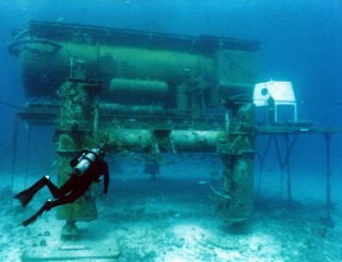 A diver swims toward the underwater laboratory Aquarius at the National Undersea Research Center in Florida.  The laboratory was used for a Georgia Tech...