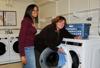 Salisbury University President Janet Dudley-Eshbach and freshman Johnita Dickerson demonstrate Salisbury University's new high-tech, energy-efficient washing...
