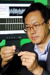 Georgia Tech Professor Zhong Lin Wang holds a prototype flexible charge pump.  The device generates alternating current as zinc oxide wires are stretched...