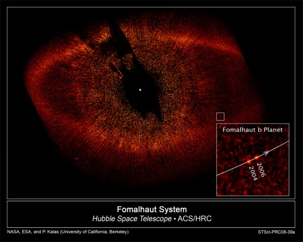 This image, taken with the Advanced Camera for Surveys aboard NASA's Hubble Space Telescope, shows the newly discovered planet, Fomalhaut b, orbiting its parent star, Fomalhaut.   The small white box at lower right pinpoints the planet's location. Fomalhaut b has carved a path along the inner edge of a vast, dusty debris ring encircling Fomalhaut that is 21.5 billion miles across. Fomalhaut b lies 1.8 billion miles inside the ring's inner edge and orbits 10.7 billion miles from its star.   The inset at bottom right is a composite image showing the planet's position during Hubble observations taken in 2004 and 2006. Astronomers have calculated that Fomalhaut b completes an orbit around its parent star every 872 years. The white dot in the center of the image marks the star's location. The region around Fomalhaut's location is black because astronomers used the Advanced Camera's coronagraph to block out the star's bright glare so that the dim planet could be seen. Fomalhaut b is 1 billion times fainter than its star. The radial streaks are scattered starlight. The red dot at lower left is a background star.   The Fomalhaut system is 25 light-years away in the constellation Piscis Australis.  This false-color image was taken in October 2004 and July 2006.