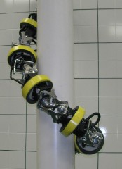 This HyDRAS serpentine robot prototype climbs a pole by converting the oscillating motion of the joints to a whole body rolling motion to climb up pole-like...