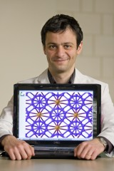 Dr. Artem Oganov shows the crystal structure of the new phase of boron.