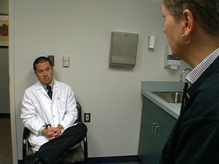William Chey, M.D. talks to patient about symptoms of celiac disease.