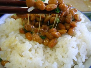 An enzyme in natto, a soybean product, could help fight Alzheimer's disease, scientists say.