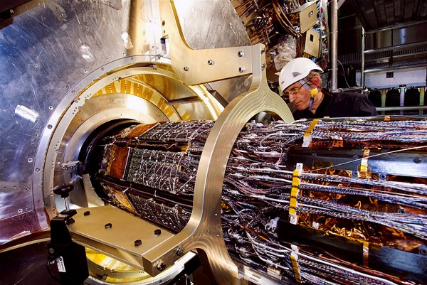 A technician helps install the pixel detector within the ATLAS detector at the Large Hadron Collider near Geneva, Switzerland. A team of Iowa State physicists is contributing to work on the pixel detector, the innermost part of the ATLAS experiment.