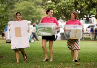 Packing belongings in reusable plastic containers helps cut down on cardboard waste during college move-in.