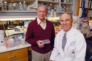 Drs. John Minna (right) and Adi Gazdar