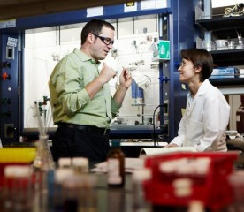 Liviu Mirica (left), assistant professor of chemistry in Arts & Sciences, and Julia Khusnutdinova, a postdoctoral researcher in his lab, work together...