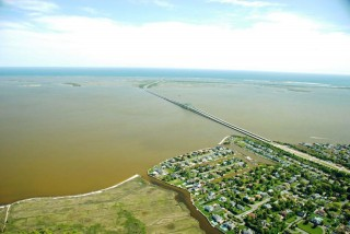 Aerial image of Great South Bay, NY, USA, during a harmful brown tide bloom caused by Aureococcus anophagefferens in June 2008.  The image contrasts the dark...