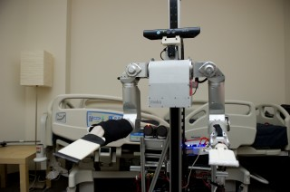 Cody, a robot in Charlie Kemp's Healthcare Robotics Lab at Georgia Tech, was used in a study testing how subjects responded to being touched by a robot...