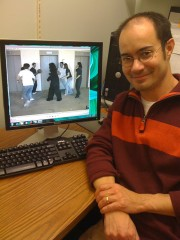 University of Utah psychologist Jason Watson displays a famous video showing people passing a basketball while a person in a gorilla suit walks across...