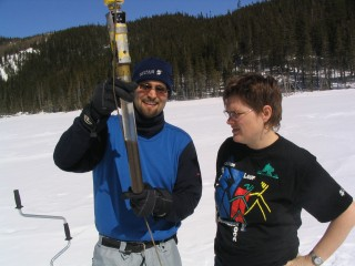 Sonja Hausmann of the University of Arkansas and her colleague Guillaume St.-Onge of the University of Québec at Lac du Sommet with a McGlue corer in March...