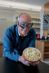 "Popcorn claims the title as ""perfect snack food"" in a new study. Joe Vinson, PhD., study leader, readies a bowl for tests in the lab."