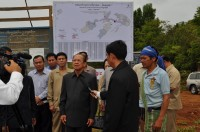 His Excellency Im Chhun Lim, Senior Minister for Land Management, Urban Planning and Construction. He is speaking with TV cameras in Andoung Kraloeng village,...