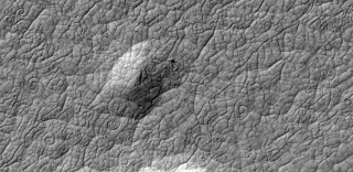 Cooling lava on Mars can form patterns like snail shells when the lava is pulled in two directions at once. Such patterns, rare on Earth, have never before...