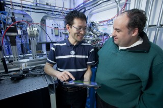 University of Saskatchewan Ph.D. student Dong Liu discusses the Science Studio remote control software with Elder Matias at the Canadian Light Source (CLS)...