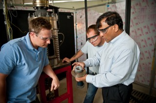 University of Alabama engineering professor Dr. Ajay Agrawal, left, with graduate students Justin Williams, right, and Joseph Meadows, center, examine...