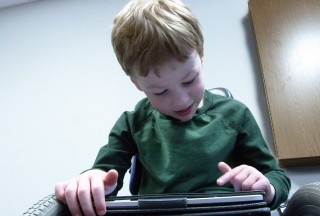 Hunter Harrison, a 5-year-old from Nicholasville, uses an iPad to help him speak.