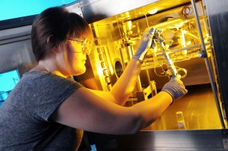 Stephanie Didas, a Georgia Tech Ph.D. candidate, loads an aminosilica sample into a custom-built volumetric adsorption system for measuring adsorption...