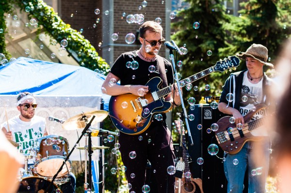 SEAM, a popular Toronto rock band, warms up the crowd of mostly first-year students before they attempt to break the Guinness World Record for the largest cow-bell ensemble.