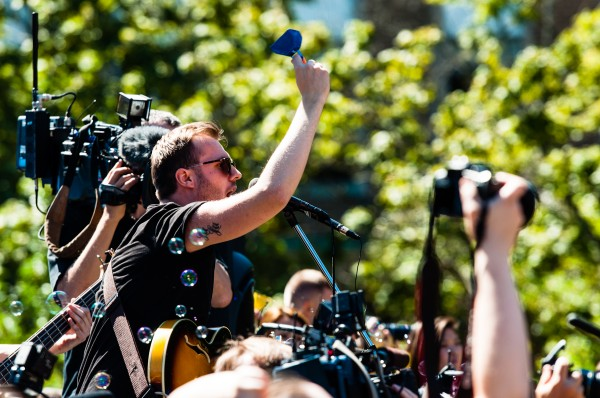 Sean Sroka, lead singer from SEAM, a popular Toronto rock band, demonstrates a musical rhythm that everyone will perform for two minutes as part of the Guinness World Record Challenge.