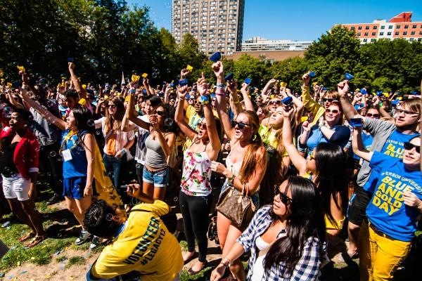 Just over 1,000 students, faculty and staff celebrate after finding out they made music history by unofficially beating the Guinness World Record for the largest cow-bell ensemble.