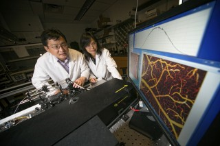 Stony Brook University Biomedical Engineering Professors Dr. Yingtian Pan, left, and Congwu Du, with novel 3D optical Doppler imaging device.