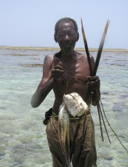 Local fisherman shows off his catch of octopus in Kenya