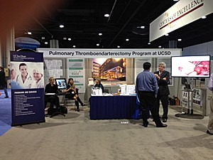 Dr. Bill Auger speaks with a colleague at the 2012 CHEST conference, hosted by AACP in Atlanta.