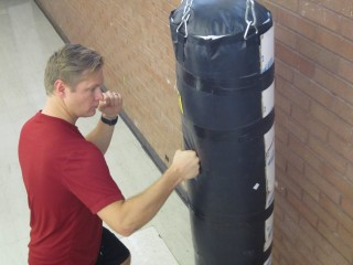University of Utah medical student Michael H. Morgan strikes a punching bag that was used by Morgan and university biology Professor David Carrier in a study...