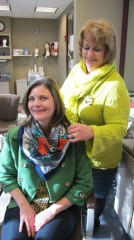 Fashion consultant and breast cancer survivor Kari Harris wearing one of the scarves she donated to Loyola's Image Renewal Center. With her is clinical...