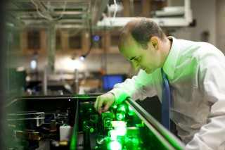 Greg Engel, associate professor in chemistry, is pictured here tuning a femtosecond laser system used to dissect couplings between nanocrystals. Understanding...