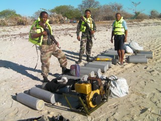 1.)	Enforcement staff from Madagascar's Centre de Surveillance des Pêches or CSP and National Gendarmerie with confiscated gear from illegal sea cucumber...