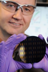 Georgia Tech Professor Clifford Henderson holds a wafer containing graphene p-n junctions.