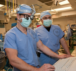 UCSF neurosurgeon Christopher Ames, MD, left, and orthopedic surgeon Vedat Deviren, MD, work together in the operating room during a spinal surgery. The two have...