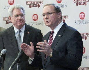 MET COLLABORATION — Mississippi State University President Mark E. Keenum, right, and University of Mississippi Chancellor Dan Jones joined forces at a news...