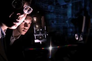 Dr. Junpeng Guo, UAHuntsville Associate Professor of Electrical Engineering and Optics, and doctoral student Haisheng Leong view the spectra from a new nanoscale...